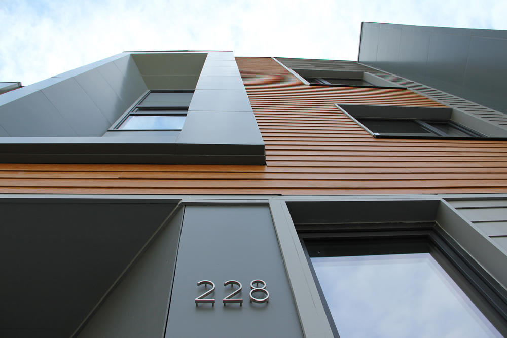 E 226 232 highland street townhouses aia top ten for Exterior building materials